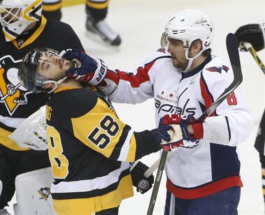 Washington Capitals Alex Ovechkin (8) shoves Pittsburgh Penguins Kris Letang (58) during the first period of Game 3 in an NHL hockey Stanley Cup Eastern Conference semifinals in Pittsburgh, Monday, May 2, 2016. (AP Photo/Gene J. Puskar)