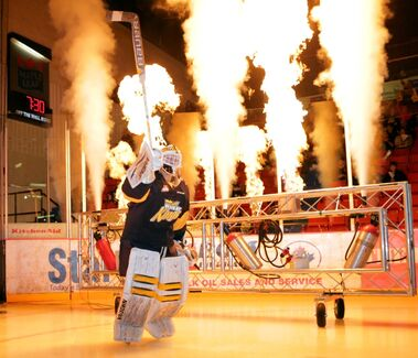Goalie Jordan Papirney salutes the crowd as he enters Westman Place in a hail of flames during the Brandon Wheat Kings season opening ceremonies, Friday evening.