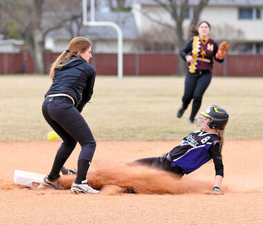 The ball eludes Crocus Plains shortstop Danielle Woychyshyn on a toss from the second baseman as Vincent Massey's Taylor Curtis slides safely into second base during the fourth inning of their Brandon High School Girls' Fastball League game on Thursday afternoon at Massey.