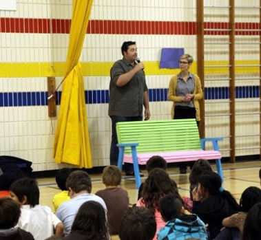 Tyler and Amber visit one of the schools receiving a new Buddy Bench, designed to foster friendship among the students.