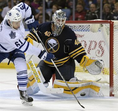 In this Sept. 29, 2015, file photo, Toronto Maple Leafs forward Connor Brown (61) deflects the puck at Buffalo Sabres goaltender Robin Lehner (40), of Sweden, during the second period of a preseason NHL hockey game in Buffalo, N.Y. Once considered the future of the franchise, Lehner will now provide the opposition as the Ottawa Senators open the regular season Thursday night against the Buffalo Sabres. THE CANADIAN PRESS/AP /Gary Wiepert