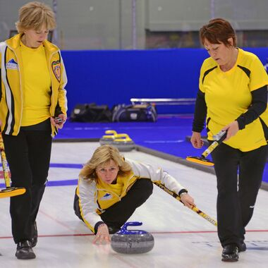 Manitoba's Terry Ursel, middle, releases a rock as second Tracy Igonia, left, and lead Brenda Walker follow it during action at last week's Canadian senior women's curling championship in Fredericton. The Arden Landsdowne club skip and her team made it to the championship pool but came up shy of reaching the playoffs.