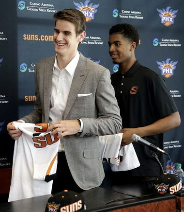 Phoenix Suns' first-round draft pick Dragan Bender, left, and Marquese Chriss, whom the Sacramento Kings drafted and then traded the rights to to the Suns, leave the podium after being introduced to the media Friday, June 24, 2016, in Phoenix. (AP Photo/Matt York)