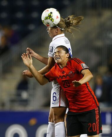 United States midfielder defender Whitney Engen (6) heads the ball over Mexico forward Luz Duarte (20) in the first half during a CONCACAF semifinal soccer match in Philadelphia, Pa., Friday, Oct. 24, 2014. (AP Photo/Rich Schultz)