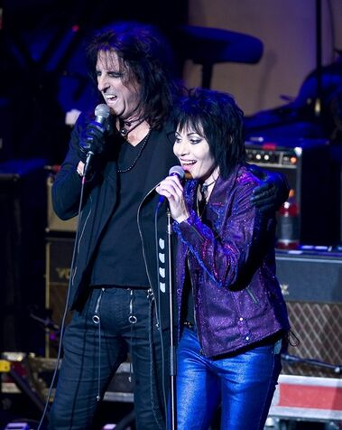 Alice Cooper, left, performs with Joan Jett at the 6th Annual Little Kids Rock benefit presented by Guitar Center at the Hammerstein Ballroom on Thursday, Oct. 23, 2014 in New York. (Photo by Stephen Chernin/Invision/AP)