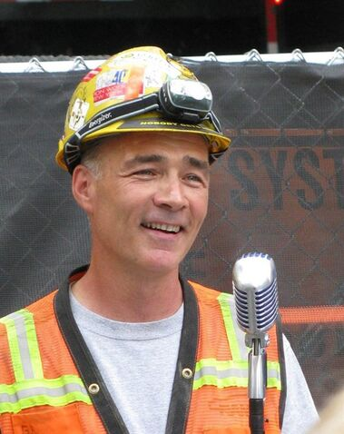 FILE - In this Aug. 5, 2011 file photo provided by Jan Nebozenko, iron worker Gary Russo stands at the microphone during a short break from helping to build the Second Avenue Subway in New York. The karaoke-loving ironworker who briefly became a New York sensation for his serenades from a subway construction site has been found dead, two months after he disappeared from his Queens neighborhood, police said Friday, Aug. 28, 2015. (Jan Nebozenko via AP, File)