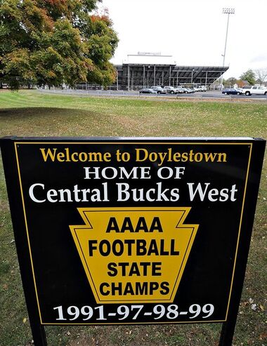 A sign for the Central Bucks West High School's football team stands in front ot the football stadium on Thursday, Oct. 23, 2014 in Doylestown, Pa. The remaining two football games at Central Bucks High School West in suburban Philadelphia have been canceled after allegations rookie players were subjected to what officials called humiliating and inappropriate initiation rites. All varsity and junior varsity coaches were also suspended pending further investigation, the superintendent said, citing the failure of staff to properly supervise team activities. Police said they would investigate whether any of the activity was criminal. (AP Photo/The Intelligencer, Rick Kintzel )