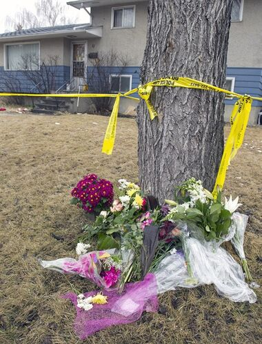 One of several flower memorials outside the scene of Tuesday's multiple fatal stabbings in northwest Calgary, Alberta on Friday, April 18, 2014. THE CANADIAN PRESS/Larry MacDougal