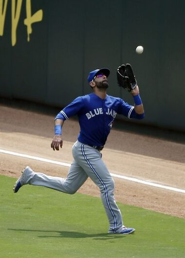 Toronto Blue Jays right fielder Jose Bautista runs down a fly-out by Texas Rangers' Adrian Beltre in the fourth inning of a baseball game Thursday, Aug. 27, 2015, in Arlington, Texas. (AP Photo/Tony Gutierrez)