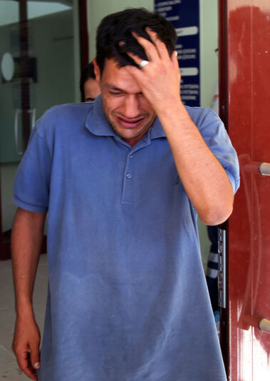 The boys' father, Abdullah Kurdi, cries as he waits for the delivery of their bodies outside a morgue on Thursday in Mugla, Turkey. Kurdi said he wanted one thing: to sit by the graves of his wife and children.