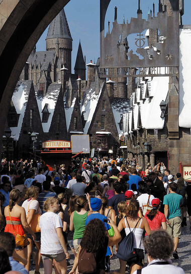 """Guests enter the Wizarding World of Harry Potter in Orlando, Fla., during the theme park's opening in 2010. École secondaire Neelin High School student Rashmini Shunmugam visited the park over the Christmas holiday and said he experienced """"some of the best moments"""" in his life."""