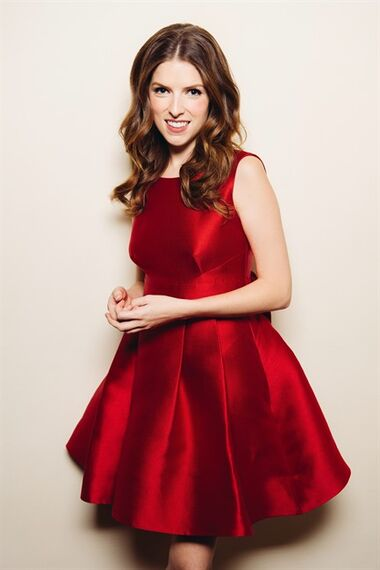 In this Friday, Oct. 3, 2014 photo, Anna Kendrick poses for a portrait at Chateau Marmont during an interview in West Hollywood, Calif. Kendrick is in the holiday spirit. Her red, sleeveless party dress is from Kate Spade New York's holiday collection is featured in the company's upcoming advertising campaign starring Kendrick. (Photo by Casey Curry/Invision/AP)