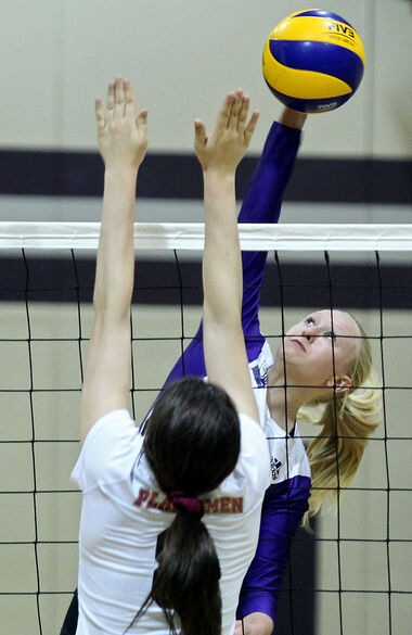 Shayla Heinrichs hammers one of her 15 kills on the night for Vincent Massey.