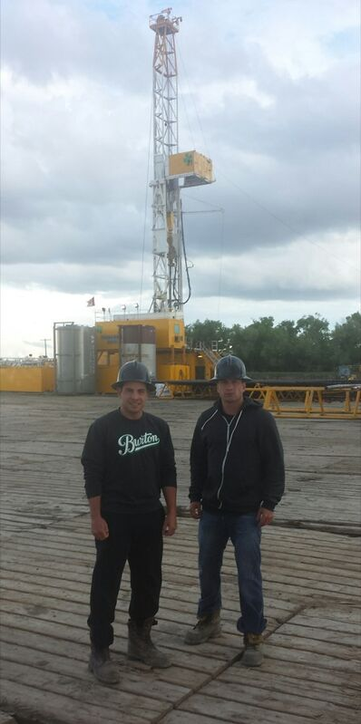 Eddie and Trevor Rozander standing in front of a rig near Stoughton, Sask. The brothers are part of a three-man crew of directional drillers, which includes their older brother Mike, who drill horizontal holes in southwestern Manitoba and southeastern Saskatchewan.