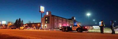 Brandon Police Service vehicles block off the entrance to the parking lot of the Motel 6 on the Trans-Canada Highway in Brandon on Wednesday evening.