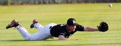 Brandon Marlins left fielder Tanner Jago attempts a diving catch during a Manitoba Senior Baseball League game last season against the Reston Rockets.