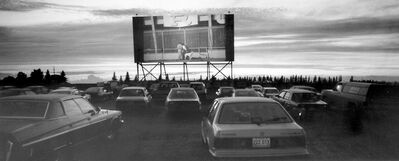 Vehicles park at the former Lucky Star Drive-In on Highway 10, giving passengers a good view of the screen. The popular theatre closed in 2003 and Star Wash and Service had the screen taken down to make room for business expansion.