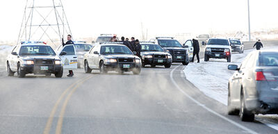 Brandon police and RCMP members congregate at the scene of a takedown after a stolen car hit the ditch on Highway 110 east of Brandon after a police pursuit in January. One of the two accused in the chase and related crime spree has received a three-year prison term.
