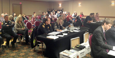 Members of the gallery listen as the three-day firefighter arbitration hearing wrapped up at the Victoria Inn on Thursday.