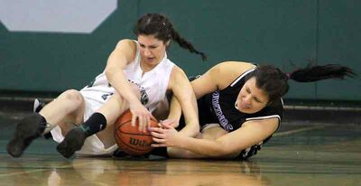 Neelin's Paige Thomson (left) and Vincent Massey's Zaina Bird hit the floor to battle for the ball on Tuesday.