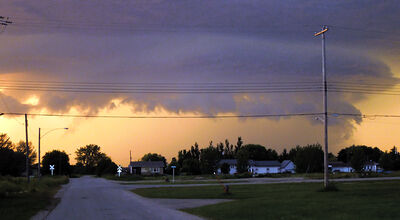 Funnel clouds are seen forming near the Hartney, where a tornado touched down for about a minute on Saturday.