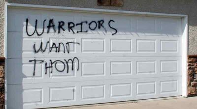 "In this September 2012 photo, a garage on the 1900-block of Ninth Street is seen with the message ""Warriors Want Thom"" spray painted on it. On Tuesday, a teen with no connection to a gang admitted to spraying the message and pleaded guilty to mischief."