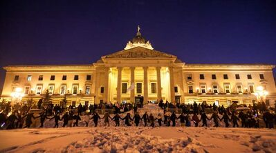 A round dance at the legislature included Glow Stick-waving participants. About 500 people gathered Monday.