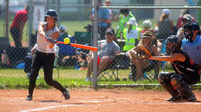 Morgan Glowa connects with a pitch for the Westman Magic during Sunday's senior women's softball final at Simplot Millennium Park. The Magic defeated the Winnipeg Lightning 9-4.