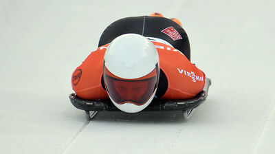 Jon Montgomery speeds down the track during his first run of the men's Skeleton World Cup race in Innsbruck, Austria, on Saturday.