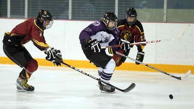 Massey's Bradley Schoonbaert (centre) is pursued by Crocus' Taylor Maloney (left) and Cole Fraser Tuesday.