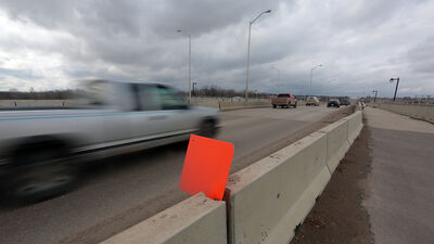 Bump signs mark the approach to the David Thompson Bridge along 18th Street in Brandon on Thursday afternoon.