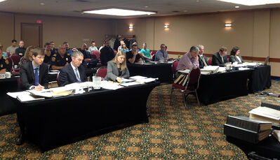 Officials take part in the second day of the firefighter arbitration hearing at the Victoria Inn, during which the city made its case for holding a pay increase to a total of six per cent over three years. The hearing is expected to wrap up today.
