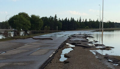 As the Assiniboine River recedes, it reveals some damage has been done to First Street, where portions of the shoulder asphalt have clearly been washed away, as seen Monday morning, July 21, 2014.