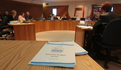 Brandon School Board trustees deliberate over the division's budget in February. Eleven full-time teaching positions cut from the 2014-15 budget have been dealt with through teacher retirements or not renewing term contracts.