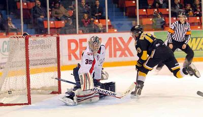 Brandon Wheat Kings sniper Alessio Bertaggia rifles the puck past former Wheat King netminder Ty Rimmer of the Lethbridge Hurricanes at Westman Place on Nov. 9.