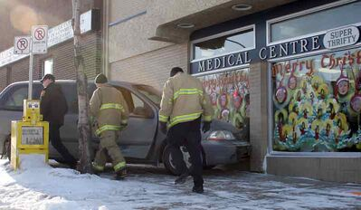 A van is shown lodged in the window of the Medical Centre Super Thrifty Pharmacy on Sixth Street on Saturday. The van was involved in a collision with another vehicle before sliding into the building.