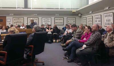 Kingsway Kort residents gather in council chambers during Monday's city council meeting to speak against the rezoning of property that includes the modular home park at 1640 Sycamore Dr.