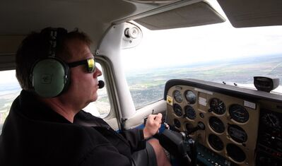 Greg Harasymchuk, who has been flying for more than 25 years and is the Brandon Flight School's director, navigates the skies above Brandon in a Cessna 172.