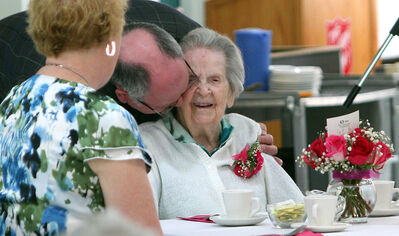 Resby Coutts leans in and gives his aunt, Winifred Greaves, a kiss during her birthday celebration at Dinsdale Personal Care Home on Tuesday. Greaves turned 108 yesterday.