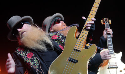 Dusty Hill and Billy Gibbons of ZZ Top entertain fans during Wednesday night's concert in Westman Place at the Keystone Centre.