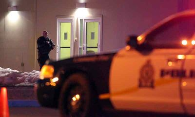 A Brandon Police Service officer stands outside the Motel 6 on the Trans-Canada Highway in April following a homicide at the hotel. A 26-year-old New Brunswick man had killed his own father, but in October,  a judge ruled the man was not criminally responsible due to a mental disorder.