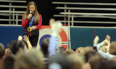 Olympic curling gold medallist Kaitlyn Lawes answers questions from students at Meadows School on Monday morning.