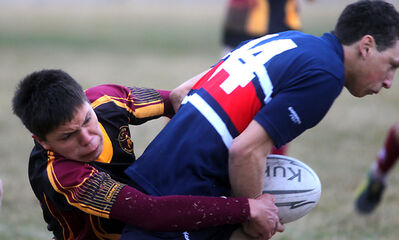 Crocus Plainsmen Reece Taylor puts a tackle on Minnedosa Chancellors' Alex McPherson during Tuesday's match at John Reilly Field.