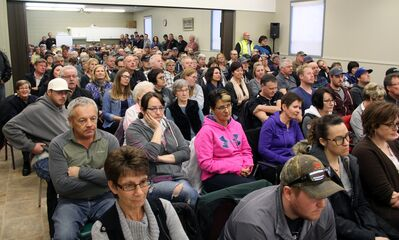 People were left standing along the back and in doorways Thursday night for a municipal board hearing in Deloraine attracting more than 250 people.