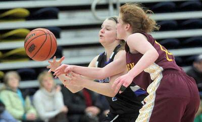 Souris Sabres' Kristen Leverington and Crocus Plains' Michelle Kyle battle for control of the ball during a matchup at the Bobcats' New Year's Basketball Classic on Saturday.