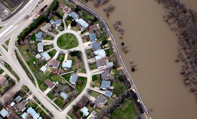 In this May 12, 2011, photo, the Assiniboine River overflows its banks in Brandon.