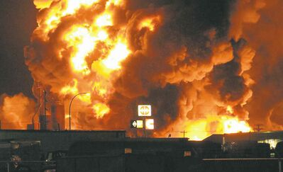 Josh Wood / The Associated PressA fire at Red River Supply in Williston, N.D., rages early Tuesday. The blaze is expected to burn for at least another day, emergency officials said.