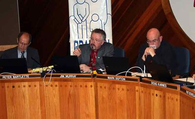 Trustees (from left) Peter Bartlette, Jim Murray and Mark Sefton debate the Brandon School Division's four-point plan to deal with increasing enrolments on Monday night.