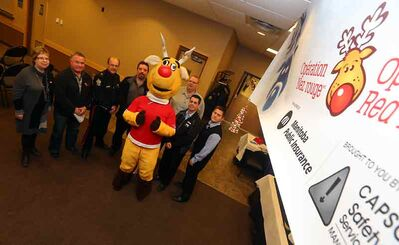 Operation Red Nose officially kicks off its annual campaign with their sponsors at the Keystone Centre on Friday. From left: Safety Services Manitoba president Judy Murphy, Gladden Smith of the Westman and Area Traditional Christmas Dinner, Brandon Police Service Insp. Ian Grant, Chris Heide of CAA Manitoba, Rudy, Earl Cheasley (Manitoba Liquor Control Commission), Jason Krieser (Keystone Centre) and Jeff Sass (Manitoba Public Insurance).