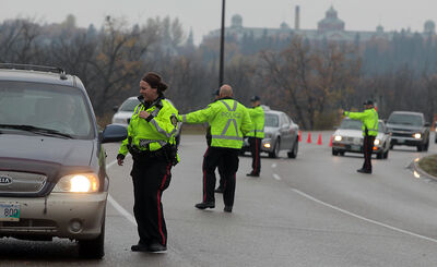 Brandon police conduct a checkstop on First Street North in October 2013. Despite a provincial ban that has been in effect since 2010, distracted driving has overtaken impaired driving as the top safety concern on our roads, according to CAA Manitoba.